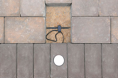 Fixture to circuit cable connection under paver